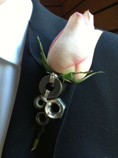 Unique boutonniere featuring washers and nuts.  The ultimate in manly. Wedding flowers created by Brooke Raulerson of Amelia Island Wedding Flowers, *An Artistic Florist Company. www.ameliaislandweddingflowers.com