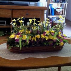 Longaberger Basket filled with spring flower mix. So cuteee!! :)