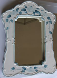 The pretty mirror shown is AN EXAMPLE of one that I custom-made for Rachel. It is not for sale. However I am showing it to let buyers know how they can order a custom-made mirror, picture frame (or other item) for themselves, and explain the process. First Rachel gave me an idea