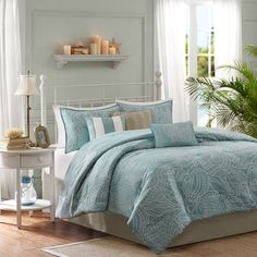 Cleo Comforter Set | Joss & Main. I love the background theme and pattern. The colors give a nod to the beach theme. Comes with numerous pieces.