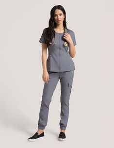 Hidden Zipper Top in Graphite is a contemporary addition to women's medical scrub outfits. Shop Jaanuu for scrubs, lab coats and other medical apparel. Spa Uniform, Scrubs Uniform, Dental Scrubs, Medical Scrubs, Lab Coats For Men, Dental Uniforms, Nursing Uniforms, Scrubs Pattern, Stylish Scrubs