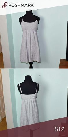 Adorable Grey Flowy Dress In excellent condition. Very soft and comfortable. Extremely Stretchy!  Buy three items and get one free plus 15% off your purchase total! Dresses Midi