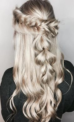 Rock a gorgeous princess braid for spring using Wella EIMI Dry Me for texture and Oil Reflections Luminous Smoothing Oil for added shine.