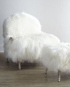Old Hickory Tannery Worthen Sheepskin Chair & Ottoman - Horchow.  This might work if I had a white cat.