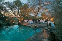 Evening Poolside Party party lights home outdoors pool decorate evening entertain ideas tables