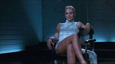 In one of the most famous scenes in Basic Instinct, Sharon Stone wears a sleeveless turtleneck dress... - Provided by Cosmopolitan