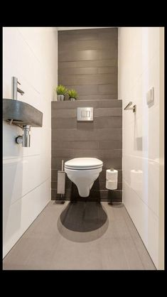 Small toilet room - This is contrast because the white walls are contrasting with the darker back wa Genel Small Downstairs Toilet, Small Toilet Room, Guest Toilet, Downstairs Bathroom, Toilet Wall, Small Toilet Design, Bathroom Design Small, Bathroom Interior Design, Modern Bathroom