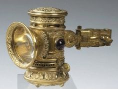 The ornate brass SEARCH LIGHT Bicycle Lamp  manufactured by The Bridgeport Brass Company.  Louis Hornberger's Pat. No. D28,080, Dec. 21, 1897.