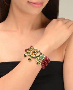 Multi Strand Maroon Beaded Bracelet with Kundan Brooch  by Just Jewellery
