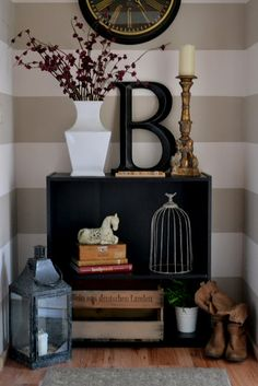 The black initial and white vase are striking on this table in the entrance.