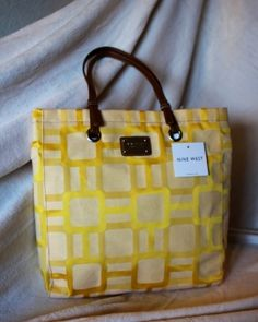 """Nine WestBag CODE: YFC-B00014 COLOR: yellow LENGTH:13.25"""" WIDTH:3"""" HEIGHT:14"""" for more info contact 09065840620 or 09323405246"""