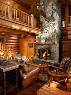 The centerpiece of the great room is clearly the soaring stone fireplace, which features Montana moss rock that matches the home's exterior stone.
