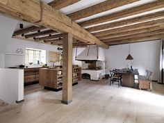 """Unique """"Model Dinesen""""-carpenter kitchen – here in a protected old property at Christianshavn in Copenhagen. Dinesen's long floorboards gives a unique look in the drawer fronts from start to finish, as the fronts horizontally have been created out of one plank, so you get a continuous flow of grain patterns. The browned brass sink complements Dinesen HeartOak really well, giving an exclusive look. See more at www.bynordichands.ch"""
