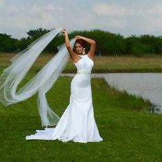Pretty bride with veil in wind by one of the pond's. #veil #bridal #texasranchvenue #eventcenter #wedding #averygreen #model #weddingdress #barn #rusticwedding www.tinspurranch.com