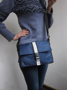This is a stylish unisex messenger bag in a trendy navy color. It is made of water resistant fabric. Its middle sized, but it has enough pockets, so you definately will find the right place for all your things.  It also has big zippered section at the back to keep your most precious things secure.  All the using parts of the bag are double or triple stitched. The bag is fully lined. Lining is made of sturdy fabric so you can be sure that the bag is super sturdy upside and inside and will…