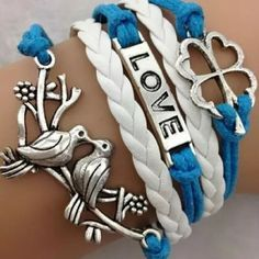 Love Birds Clover Leaf Braided Layered Bracelet Makes for a cute gift! Blue and white faux braided leather with silver plated Charms! Adjustable up to 9 inches as well! Handcrafted Jewelry Bracelets