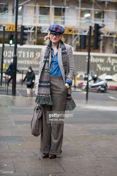 The Rake Editor Sarah Ann Murray wears a blue and red plaid flat cap, fair isle scarf, Ralph Lauren tweed jacket and loose-trousers, and chambray button-up shirt during The London Collections Men AW16 at on January 9, 2016 in London, England.