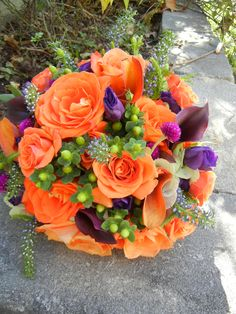 eggplant callas, orange roses, green berries fall bouquet designed by tina barrera