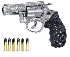 rhinestone gun it's cute and makes me laugh at the thought of some criminal telling others he was shot with a rhinestone gun!