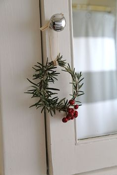 Deck the halls with mini wreaths. These are so cute, and an easy DIY project, made with rosemary and red berries.