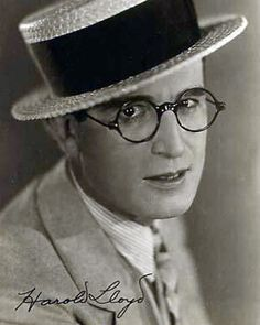 A small staged portrait of Harold Lloyd wearing his trademark straw hat and glasses - photograph taken in Silent Screen Stars, Silent Film Stars, Harold Lloyd, Jill Clayburgh, Cincinnati Kids, Maureen O'hara, Old Movie Stars, Ann Margret, Orson Welles