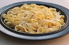 Fettuccine all'Alfredo - The original owner of Alfredo's Restaurant in Rome, Alfredo Di Lelio, is said to be the originator of this delicious dish of worldwide fame. The quality and taste of the ingredients is the key to success, especially the fettuccine and the cheese. The fettuccine should be freshly made or the best fresh (not dry), thinnest pasta you can buy. Fettuccine Alfredo is finished in the pan, the cooked and drained pasta is added directly to the warmed ingredients in the pan.