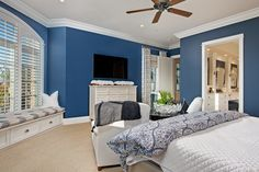 Master Bedroom with nautical themed decorations, cute bay window seating area with private master bathroom