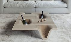 Container coffee table made of 100% three dimensional corrugated cardboard, it is the result of artisanal assembly 120 cardboard profiles. It is designed for the food