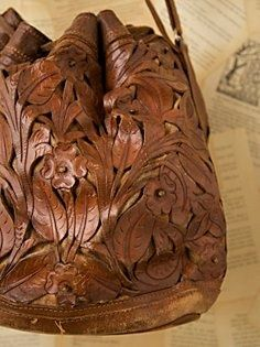 Ok so it may not be laser cut but it could be! Love this Vintage 1950s Tooled Leather Bag: