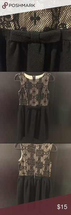NWOT Black Lace Bow Dress NWOT Black Lace Dress with Bow. Textured skater skirt with lace top. Silver zipper down back. Sister's dress but it was too small for her and too late to return it. Brand is Rewind. Size M. Purchased at Macy's. Macy's Dresses Mini