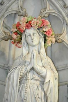 A crown of roses adorns the head of a statue of Mother Mary in Cathedral of St. John the Baptist. (John Carrington/Savannah Morning News)