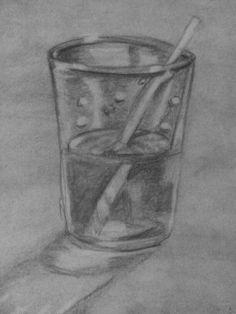 Glas water met een rietje