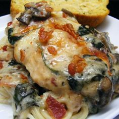 "Chicken Florentine Casserole | ""Chicken Florentine casserole, which can also be adapted with either fish or shrimp, lies on a bed of spinach leaves and mushrooms, has a creamy white sauce mixed with garlic, Parmesan cheese, and Italian seasonings, and is topped with baked mozzarella."""