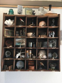 Cubby curation. Curated curiosities, vintage finds and nature collections. Pottery Barn cubby organizer.
