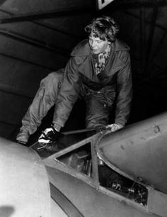 Amelia Earhart climbs out of her plane at Oakland Airport after completing her 18-hour, 2,400-mile flight from Honolulu on Jan. 14, 1935.