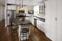 L Shape Kitchen Layout Ideas With Kitchen Island In The Middle Refrigerator Mounted In Cabinet Kitchen Layout Ideas