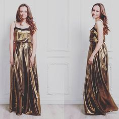 Elegant gold metallic tank top with black trim. This is our idea of the perfect going-out top. Pair it up with a matching long skirt or go for more casual night look with jeans. Long gold metallic skirt with pockets. Will make you the center of attention at a party or social event. Pair it with a matching metallic cami or get creative!