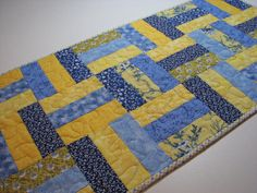 Blue and Yellow Quilted Table Runner by VillageQuilts on Etsy, $40.00 I have admired this, and admired this-- then I realized I could have it! So I bought it! Support the folks that make beautiful things!