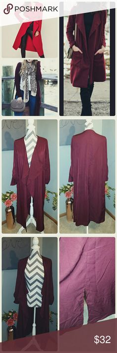 Maroon Duster Adorable long duster. Has slit in the back, belt loops but don't have the belt, never wore it with the belt. Very cute left open as a duster but could be worn w a black skinny belt.   Color: Deep Maroon Jackets & Coats