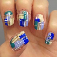 Artsy abstract nail art design. Looking for something out of the blue? This design is simply perfect with its light colors and simple design with a touch of gold glitter polish on top.