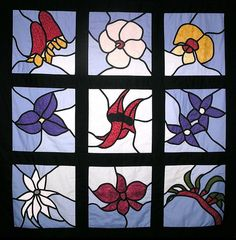 A stained glass applique wall hanging made from a design by Margaret Rolfe. Australian Wildflowers, Australian Flowers, Applique Wall Hanging, Quilted Wall Hangings, Stained Glass Quilt, Stained Glass Patterns, Mosaic Art, Mosaic Glass, Quilting Projects