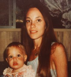 Good genes: Rare baby pictures show Angelina Jolie with her look-alike mother Marcheline Bertrand.