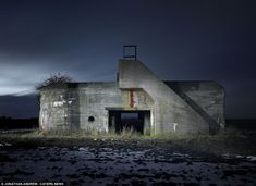 The ghosts of Hitler's European fortress: Photographer captures images of decaying World War Two bunkers in Holland, France and Belgium