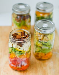 Salads in a jar - must try for school lunches next year!  Bottom layer is wet & dressing, then greens/veggies, and dry stuff on top.  She claims they stay fresh all week - Genius!