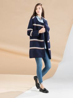 Keep the contrasts going with this navy striped coat
