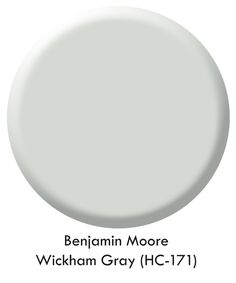 Benjamin Moore Wickham Gray *HC-171) which has gorgeous aqua undertones..with chunky Decorator White mouldings..white plank ceiling with coffered white beams....wide crown plus super wide baseboards and dark wide plank distressed hardwood floors.