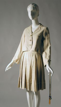 Geoffrey Beene Woman's Suit: Jacket, Skirt and Belt c. 1980s Medium: Jacket and Skirt: natural linen. Belt: linen and leather
