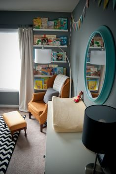 Like the floating book shelf. I would be easy to keep the nice books up high and the board books down low.