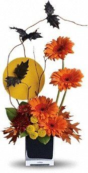Black bats fly above a full moon and spirited fall flowers in this fun Halloween floral arrangement. A stylishly spooky way to decorate your home or office for Halloween! Halloween Office, Halloween Gifts, Holidays Halloween, Halloween Decorations, Office Decorations, Halloween Party, Halloween Centerpieces, Chic Halloween, Floral Decorations