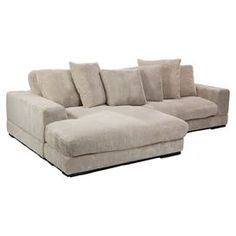 Cushioned sectional sofa with cappuccino upholstery and a hardwood frame.    Product: Sectional sofa   Construction Material: Polyester corduroy and hard wood   Color:  Cappuccino   Features: Dual configuration   Large seating area   Will enhance any dcor  Dimensions: 16.5 H x 106.3 W